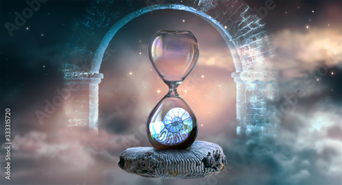 Hourglass hovering in space with ammonite inside clock that standing on ancient fossil against starry cloudy sky and ghost arch Canvas Print