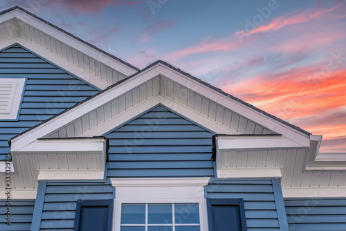 Triangle shape decorative gable with colonial white soffit and fascia on a blue Canvas