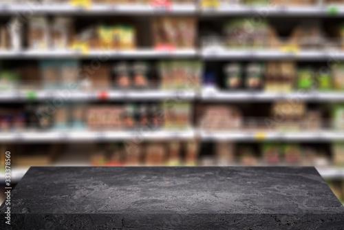 Obraz Black stone surface on blurry background at grocery store. - fototapety do salonu