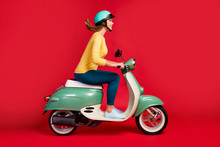 Profile Side View Of Her She Nice Attractive Lovely Cheerful Cheery Girl Driving Moped To College High School Motion Adventure Isolated On Bright Vivid Shine Vibrant Red Color Background