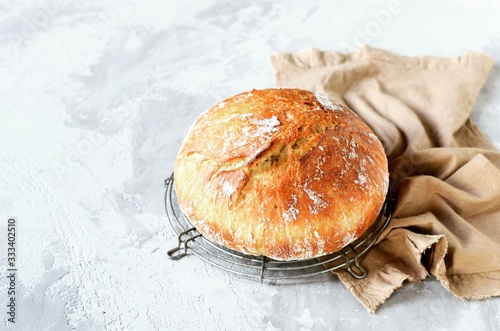 Fototapeta Tasty homemade bread on a gray background obraz