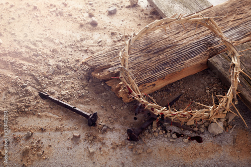 Stampa su Tela Easter background depicting the crucifixion with a rustic wooden cross, crown of thorns and nails