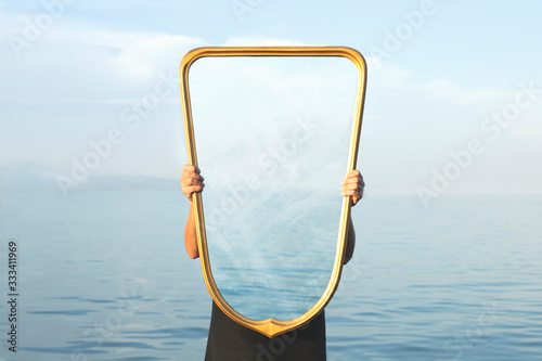 Fotomural surreal image of a transparent mirror; concept of door to freedom