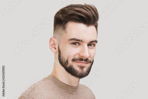 Fototapeta Closeup portrait of handsome smiling young man. Laughing joyful cheerful men studio shot. Isolated on gray background obraz