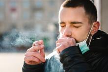 Smoking. Closeup Man With Mask...