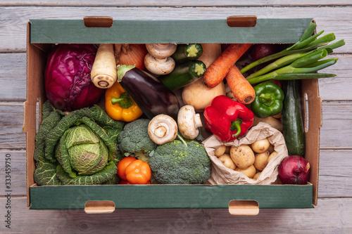 Fototapeta Fresh organic vegetable delivery box on a wooden background obraz