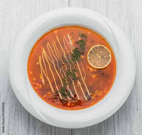 Photo Russian and Ukrainian soup solyanka. Saltwort or barilla.