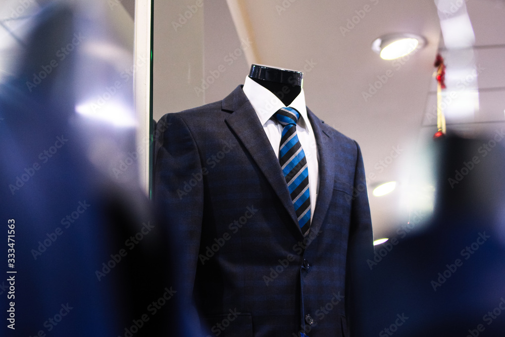 Fototapeta classic suit with a tie on a mannequin