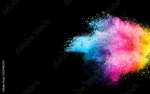 Fototapeta Freeze motion of colorful color powder exploding on black background