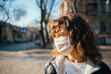 Young Woman In Protective Face Mask Looking Away