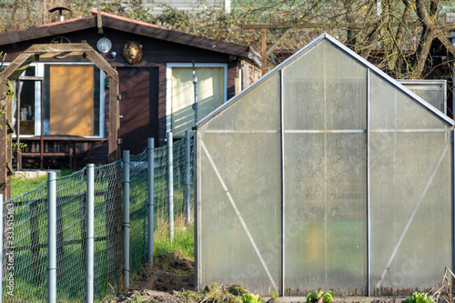 greenhouse in garden allotment Canvas Print