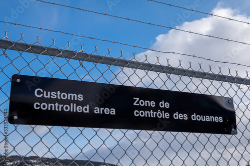 A customs controlled area sign with white letters on black metal Canvas Print