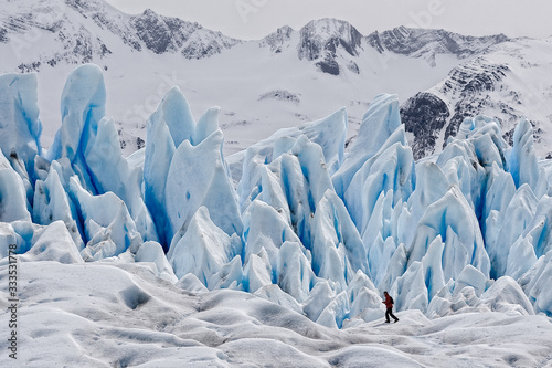Obraz na plátně A hiker on blue ice at Perito Moreno Glacier, located in the Los Glaciares National Park in southwest Santa Cruz, Argentina