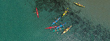 Aerial Drone Ultra Wide Photo Of Young Athlete Team Practising Sport Canoe In Tropical Exotic Bay With Emerald Sea
