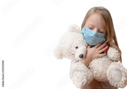 Coronavirus covid-19 and pollution protection concept. little child girl hugging teddy bear doll with wearing mask to against corona virus and air pollution pm2.5 on white background