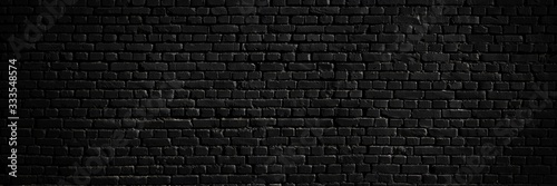 Texture of a black brick wall as a background or wallpaper Canvas Print