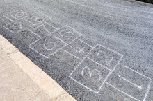 Hopscotch Drawn On A Road With...