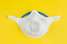 Ffp2 Mask On Yellow Background For Protect Droplets Infectious Disease From Infectious People. Face Mask Protection Against Pollution, Virus, Flu And Coronavirus.
