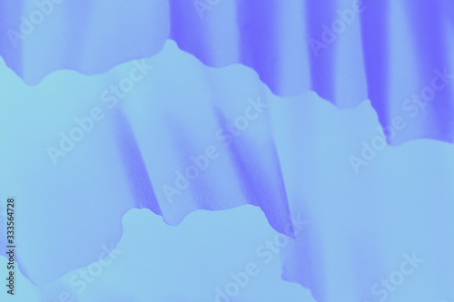 Pale gray and violet gradient background with paper waves