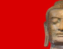Head  Buddha Statue On Red Background