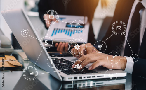 Obraz Working team meeting concept, business using laptop and smart phone and digital tablet computer with digital marketing media  in virtual icon network diagram office in morning light - fototapety do salonu