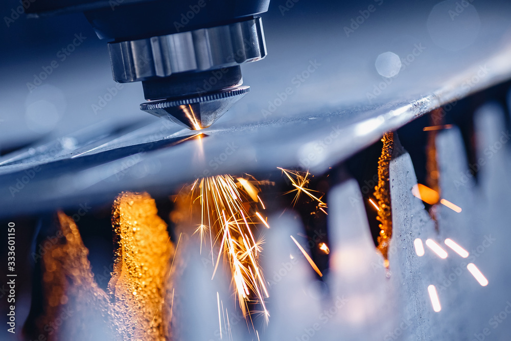Fototapeta Laser CNC cutting of metal with light spark Industrial manufacture technology