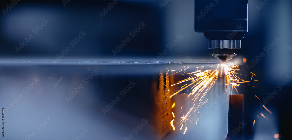 Fototapeta Blue color Laser CNC cut of metal with light spark, technology modern industrial