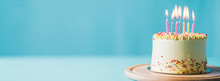 Birthday Cake With Candles Food Anniversary Concept Cover Banner Background.