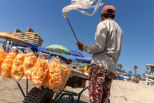 Street Vendor On Beach Selling...