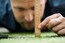 Man Using Measuring Scale Whil...