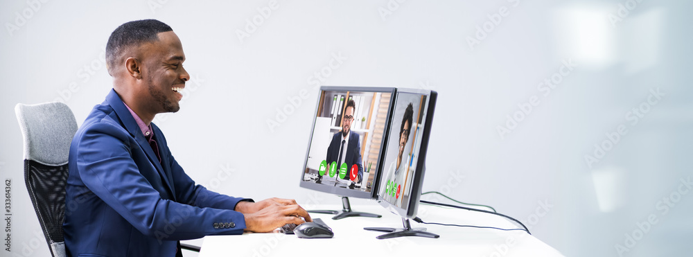 Fototapeta Businessman Video Conferencing On Computer