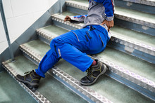 Worker Man Lying On Staircase