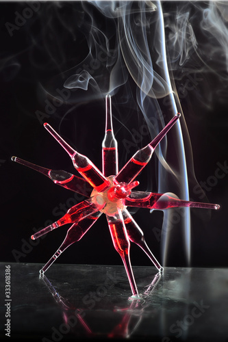 Glass ampoules with a red medicine coronavirus treatment glued together in two c Slika na platnu