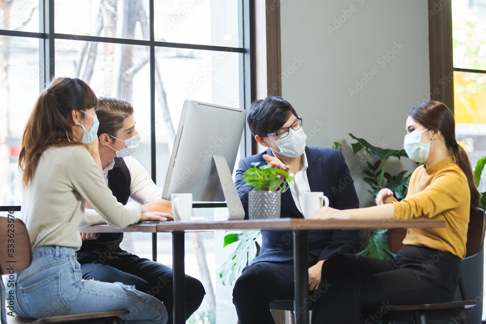 Fototapeta Group of business people with wearing hygienic mask prophylactic manager talking in meeting work room planning.