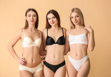 Beautiful Young Women In Underwear On Color Background