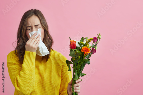 Pretty girl is allergic to the bouquet of flowers she just got Wallpaper Mural