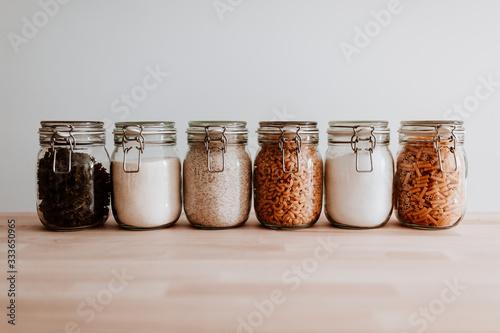 Obraz na płótnie Six glass jars full with dried uncooked food ingredients