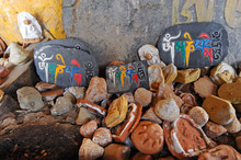 """Religious Mani Stones In Tibet (translation Of Text Written On Stones """"om Mani Padme Hum"""": """"hail To The Buddha In The Lotus"""")"""