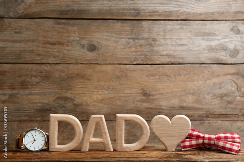 Composition with word DAD and heart on wooden background, space for text Billede på lærred