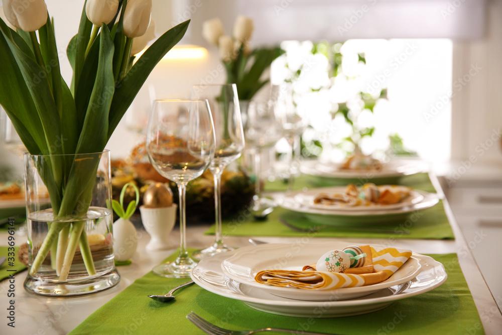 Fototapeta Festive Easter table setting with floral decor