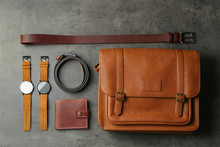 Flat Lay Composition With Leather Bag And Accessories On Grey Stone Table