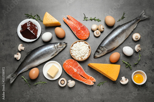 Fototapeta Fresh products rich in vitamin D on grey table, flat lay obraz