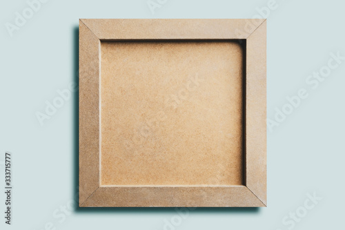 Cuadros en Lienzo Wooden picture , isolated on blue background