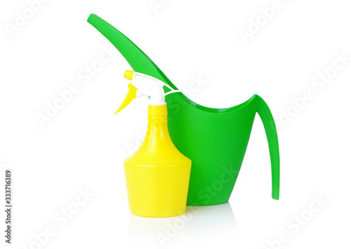 Fototapeta Garden watering tools: spray bottle and watering can isolated on white