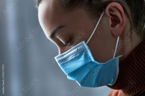 Canvas Print Upset depressed melancholy woman in protective face mask with during illness, coronavirus outbreak and flu covid epidemic