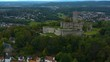 Aerial view of the city and castle Königstein im Taunus in Germany. On a cloudy day in autumn.