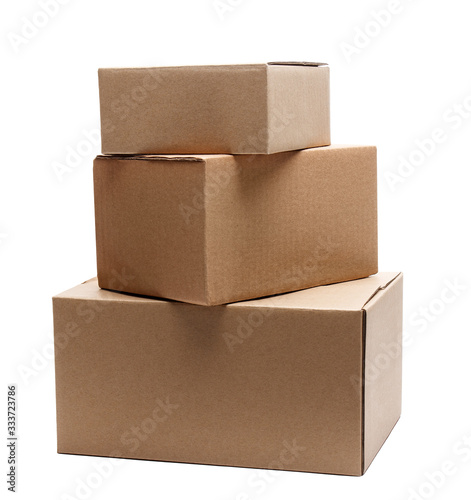 Obraz stack of three cardboard boxes of different sizes isolated on white - fototapety do salonu