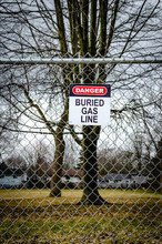 Buried Gas Line Sign On A Park Fence