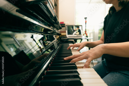 Tablou Canvas Scene of piano lessons online training or E-class learning while Coronavirus spread out or covid-19 crisis situation, vlog or teacher make online piano lesson to teach students pupils learn from home