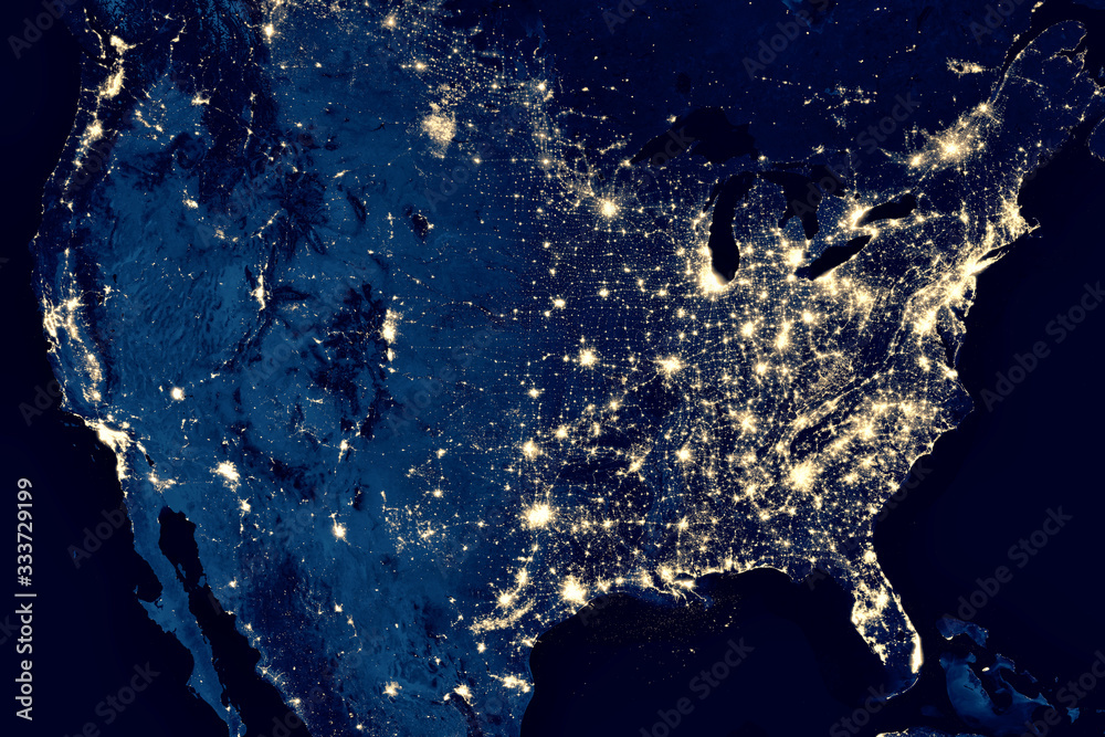 Fototapeta Earth at night, view of city lights in United States from space. USA on world map on global satellite photo. US terrain on dark planet.